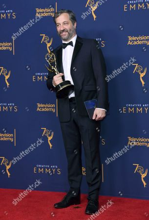 """Stock Image of Judd Apatow winner of the award for outstanding documentary or nonfiction special for """"The Zen Diaries of Garry Shandling"""" poses in the press room during night two of the Creative Arts Emmy Awards at The Microsoft Theater, in Los Angeles"""