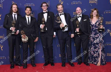 """Stock Image of Michael Bonfiglio, Joe Beshenkovsky, Sam Fishell, Judd Apatow, Josh Church, Amanda Glaze. Michael Bonfiglio, left, Joe Beshenkovsky, Sam Fishell, Judd Apatow, Josh Church, and Amanda Glaze winners of the award for outstanding documentary or nonfiction special for """"The Zen Diaries of Gary Shandling"""" pose in the press room during night two of the Creative Arts Emmy Awards at The Microsoft Theater, in Los Angeles"""