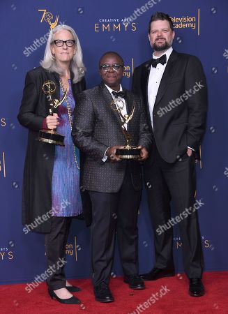 "Joslyn Barnes, Yance Ford, Alan Jacobsen. Joslyn Barnes, left, Yance Ford, and Alan Jacobsen winners of the award for exceptional merit in documentary filmmaking for ""Strong Island"" pose in the press room during night two of the Creative Arts Emmy Awards at The Microsoft Theater, in Los Angeles"