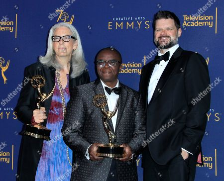 Producer Joslyn Barnes (L), cast member and producer Yance Ford (C) and associate producer Alan Jacobsen (R) hold the Emmy for Exceptional Merit in Documentary Filmmaking for 'Strong Island' during the 2018 Creative Arts Emmy Awards at the Microsoft Theater in Los Angeles, California, USA, 09 September 2018. The Creative Arts Emmy Awards honor excellence in Television technical categories such as makeup, casting direction, costume design, editing and cinematography. The 70th Primetime Emmy Awards Ceremony will take place on 17 September 2018.
