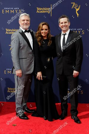 Australian former senior executive of the Church of Scientology International Mark Rinder (L), US actress Leah Remini (C) and US producer Nad Aaron Saidman (R) arrive for the 2018 Creative Arts Emmy Awards at the Microsoft Theater in Los Angeles, California, USA, 09 September 2018. The Creative Arts Emmy Awards honor excellence in Television technical categories such as makeup, casting direction, costume design, editing and cinematography. The 70th Primetime Emmy Awards Ceremony will take place on 17 September 2018.
