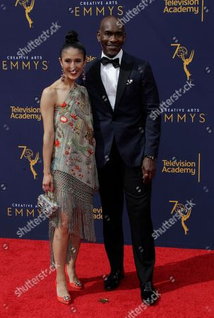 Stock Picture of US designers Laaleh Mizani (L) and Paul Tazewell (R) arrive for the 2018 Creative Arts Emmy Awards at the Microsoft Theater in Los Angeles, California, USA, 09 September 2018. The Creative Arts Emmy Awards honor excellence in Television technical categories such as makeup, casting direction, costume design, editing and cinematography. The 70th Primetime Emmy Awards Ceremony will take place on 17 September 2018.