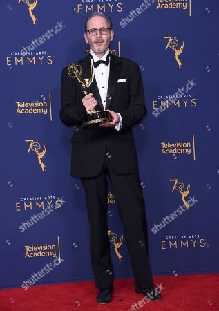 """Keith Raywood. Keith Ian Raywood, winner of the award for outstanding production design for a variety, reality or reality-competition series for the """"Host: Bill Hader"""" episode of """"Saturday Night Live"""" poses in the press room during night two of the Creative Arts Emmy Awards at The Microsoft Theater, in Los Angeles"""