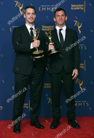 """Brian Bracken, Nick Bridgen. Brian Bracken, left, and Nick Bridgen, winners of the award for outstanding sound editing for a nonfiction program (single or multi-camera) for the """"Seattle"""" episode of """"Anthony Bourdain: Parts Unknown"""" pose in the press room during night two of the Creative Arts Emmy Awards at The Microsoft Theater, in Los Angeles"""
