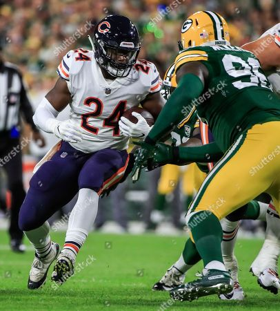 Chicago Bears running back Jordan Howard (L) runs the ball on Green Bay Packers defensive end Muhammad Wilkerson (R) in the first half of their NFL game at Lambeau Field in Green Bay, Wisconsin, USA, 09 September 2018.