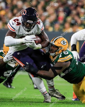 Chicago Bears running back Jordan Howard (L) is tackled by Green Bay Packers defensive tackle Mike Daniels (R) in the first half of their NFL game at Lambeau Field in Green Bay, Wisconsin, USA, 09 September 2018.