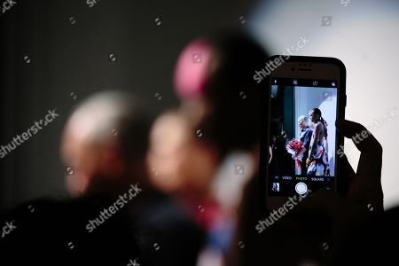 Designer Cesar Galindo can be seen through a phone photograph during his presentation at New York Fashion Week Spring 2019 in New York, New York, USA, 09 September 2018.
