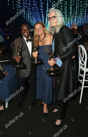 Stock Photo of Yance Ford, Ellen Kuras, Joslyn Barnes. Yance Ford, from left, Ellen Kuras, and Joslyn Barnes, attend the Governors Ball during night two of the Television Academy's 2018 Creative Arts Emmy Awards at the Microsoft Theater, in Los Angeles