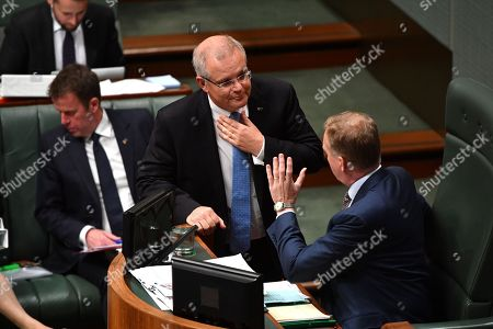 Prime Minister Scott Morrison (C) and Speaker Tony Smith (R) speak before Question Time in the House of Representatives at Parliament House in Canberra, Australia, 10 September 2018.