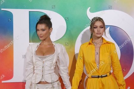 Bella Hadid, Imran Amed, Gigi Hadid. Models Bella Hadid, left, and Gigi Hadid attend the BoF 500 Gala held at One Hotel Brooklyn Bridge during New York Fashion Week, in New York