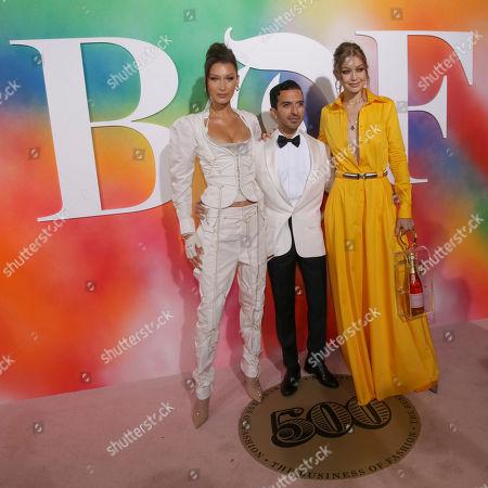 Bella Hadid, Imran Amed, Gigi Hadid. Model Bella Hadid, from left, Founder & Editor-In-Chief, The Business of Fashion, Imran Amed and Model Gigi Hadid attend the BoF 500 Gala held at One Hotel Brooklyn Bridge during New York Fashion Week, in New York
