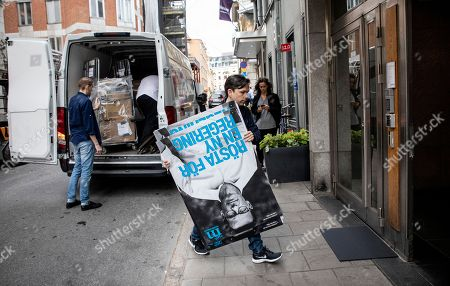 Election workers unload posters with a portrait of Moderate Party leader Ulf Kristersson outside the party headquarters in central Stockholm, Sweden, 10 September 2018, a day after the country's general election.