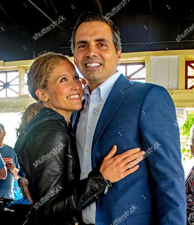 Independent candidate Greg Orman gets a hug and an adoring glance from his wife Sybil after  his stump speech at the Kansas State Fair