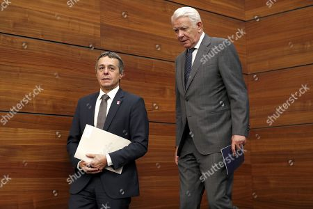 Swiss Federal Counselor of Foreign Affairs Ignazio Cassis (L) and  his Romanian counterpart Teodor Melescanu (R) leave the conference room after making a common statement that concluded their official meeting, at the Foreign Ministry Headquarters, in Bucharest, Romania, 10 September 2018.