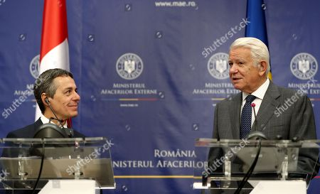Swiss Federal Counselor of Foreign Affairs Ignazio Cassis (L), accompanied by his Romanian counterpart Teodor Melescanu (R), delivers a speech at the end of their official meeting held at Foreign Ministry Headquarters in Bucharest, Romania, 10 September 2018.