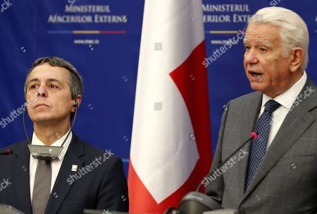 Swiss Federal Counselor of Foreign Affairs Ignazio Cassis (L) and his Romanian counterpart Teodor Melescanu (R) during a common statement that concluded their official meeting held at the Foreign Ministry Headquarters in Bucharest, Romania, 10 September 2018.