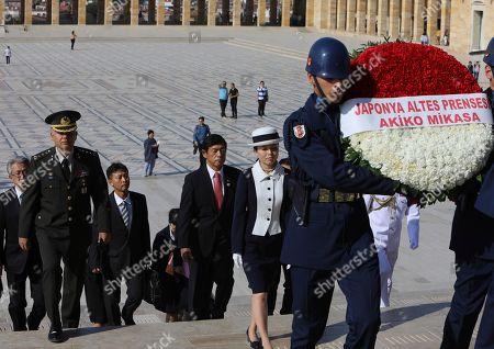 Japan's Princess Akiko walks to the mausoleum of modern Turkey's founder Mustafa Kemal Ataturk in Ankara, Turkey, during a wreath-laying ceremony, . Akiko is on a visit in Turkey