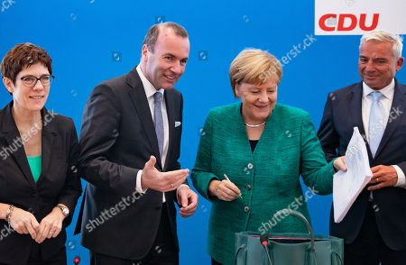 (L-R) Secretary General Annegret Kramp-Karrenbauer, Leader of the European People's Party Manfred Weber, German Chancellor Angela Merkel, Deputy Leader of the Christian Democratic Union (CDU) Thomas Strobl during a Federal Board Meeting of the Christian Democratic Union (CDU) at the CDU's headquarters in Berlin, Germany, 10 September 2018. According to the media reports, Manfred Weber is one of the major candidates to succeed European Commission president Jean-Claude Juncker in next year's European elections.