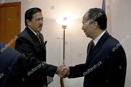 Stock Photo of China's National People's Congress (NPC) vice chairman Ji Bingxuan (R) shakes hands with Philippine Senate President Vicente Sotto III (L) during a visit inside the Philippine Senate in Manila, Philippines, 10 September 2018. Bingxuan is in Manila for a series of meetings with Filipino legislatures to forge closer ties between the two countries. The NPC is the world's largest parliament or legislative assembly and its function is largely as a formal seal of approval for the policies fixed by the leaders of the Chinese Communist Party.