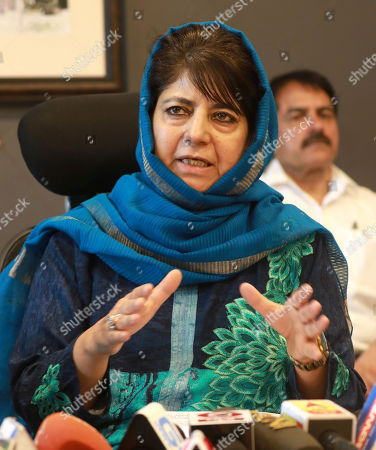Peoples Democratic Party (PDP) president and former chief minister of Jammu Kashmir,  Mehbooba Mufti speaks during a press conference in Srinagar, the summer capital of Indian Kashmir, 10 September 2018. Both PDP and National Conference (NC) have announced boycott of the upcoming municipal polls and Panchayat polls, citing unconducive atmosphere  in Kashmir over a legal challenge to Article 35-A of the Indian constitution which defines permanent residents of Jammu and Kashmir and prevents non-locals from buying or owning property in the state. Both PDP and NC demand protection to Article 35-A.