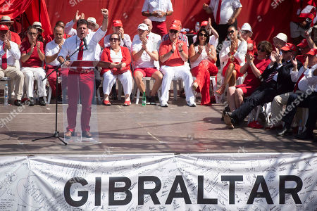 Chief Minister of Gibraltar Fabian Picardo raises his fist while giving a speech on National Day in the British territory of Gibraltar on Monday Sept.10, 2018. Gibraltar is waiting to see how Britain's future departure from the European Union could apply to Gibraltar. In the 2016 Brexit vote, 96 percent of Gibraltarians voted for Britain to remain in the EU
