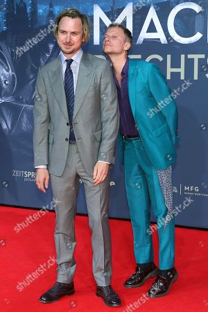 German actors Lars Eidinger (L) and Robert Stadlober pose on the red carpet prior the movie premiere of 'Mackie Messer - Brechts Dreigroschenfilm' (lit. Mack the Knife - Brecht's Threepenny Film) in Berlin, Germany, 10 September 2018. The movie opens across German theaters on 13 September.