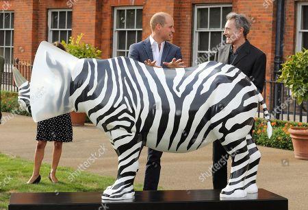 Prince William talks to artist Mauro Perucchetti at 'The Tusk Rhino Trail' celebration at Kensington Palace.
