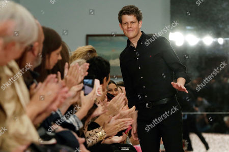 Creative Director Wes Gordon acknowledges audience applause after the Carolina Herrera spring 2019 collection was modeled during Fashion Week in New York