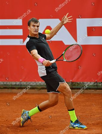 Stock Image of Poland's Konrad Drzewiecki in action against Gianluigi Quinzi of Italy during their first round match at the Challenger ATP Pekao Open tennis tournament in Szczecin, Poland, 10 September 2018.