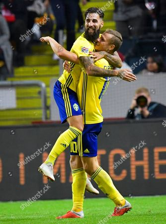 Sweden's Viktor Claesson (R) celebrates with his teammate Jimmy Durmaz (L) after scoring the 2-0 lead during the UEFA Nations League soccer match between Sweden and Turkey in Solna, near Stockholm, Sweden, 10 September 2018.