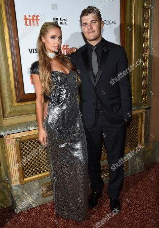 "Paris Hilton, Chris Zylka. Paris Hilton, left, and Chris Zylka attend the premiere for ""The Death and Life of John H. Donovan"" on day 5 of the Toronto International Film Festival at the Winter Garden Theatre, in Toronto"