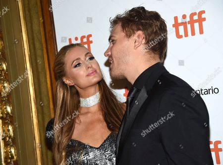 "Paris Hilton, Chris Zylka. Paris Hilton, left, kisses Chris Zylka as they attend the premiere for ""The Death and Life of John H. Donovan"" on day 5 of the Toronto International Film Festival at the Winter Garden Theatre, in Toronto"