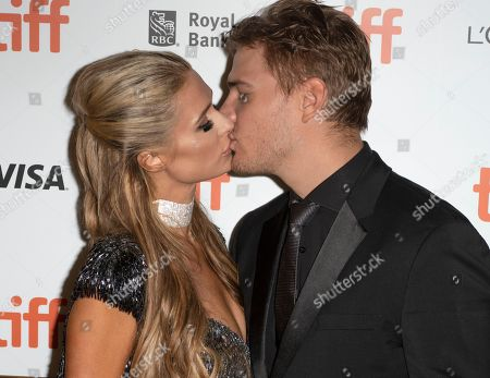 US actor and cast member Chris Zylka (R) and girlfriend Paris Hilton (L) arrive for the screening of the movie 'The Death and Life of John F. Donovan' during the 43rd annual Toronto International Film Festival (TIFF) in Toronto, Canada, 10 September 2018.