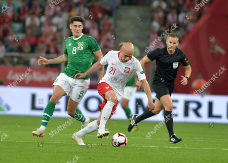 Rafal Kurzawa of Poland end Callum O'Dowda of Ireland