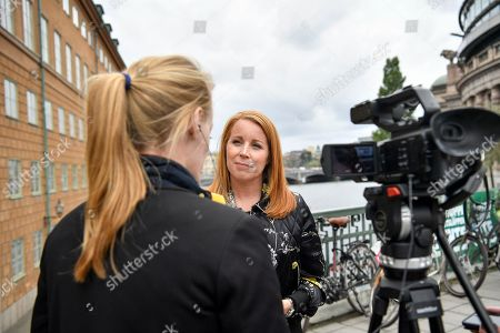 Swedish Center party leader Annie Loof talks to reporters near the parliament in central Stockholm, Sweden, 11 September 2018. General elections were held in Sweden on 09 September.