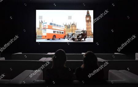 Gallery employees watch US artist Christian Marclay's The Clock at the Tate Modern in London, Britain, 11 September 2018. The show will open to the public from 14 September until 20 January 2019.