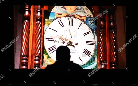 A reporter watches US artist Christian Marclay's The Clock at the Tate Modern in London, Britain, 11 September 2018. The show will open to the public from 14 September until 20 January 2019.