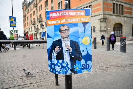A mock election poster from environmental organization Greenpeace showing a picture of Sweden Democrats party leader Jimmie Akesson and reading 'Sorry from the future. We should have put the climate first', is seen in central Stockholm, Sweden, 11 September 2018. Greenpeace campaigned against climate change as Sweden held general elections on 09 September, that has resulted in stalemate as far-right support surges.