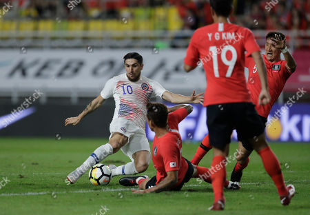 Diego Valdes, Jang Hyun-soo, Jung Woo-young. Chile's Diego Valdes, left, misses a chance to score against South Korea's Jang Hyun-soo, center, and South Korea's Jung Woo-young, right, during a friendly soccer match between South Korea and Chile at Suwon World Cup Stadium in Suwon, South Korea