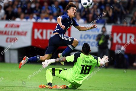 Japan's defender Ritsu Doan (L) in action against Costa Rica's goalkeeper Leonel Moreira (R) during the International Friendly soccer match between Japan and Costa Rica in Osaka, Japan, 11 September 2018.
