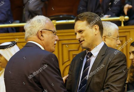 Commissioner-General of the United Nations Relief and Works Agency for Palestine Refugees in the Near East (UNRWA) Pierre Krahenbuhl (R) speaks with Palestinian Foreign Minister Riad Malki during the Arab Foreign Ministers annual meeting at the Arab League headquarters in Cairo, Egypt, 11 September 2018. Arab Foreign Ministers are holding their 150th annual meeting that will discuss several topics including the US decision to end all funding to the United Nations Relief and Works Agency for Palestine Refugees in the Near East (UNRWA).