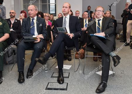 """Prince William (C) and Chief Executive of Mind Paul Farmer (R) launch """"Mental Health At Work"""" at The Engine Shed"""