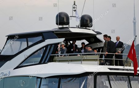 Japan's Princess Akiko, waves as she embarks on a cruise in the Bosporus Strait, separating Europe and Asia, following a visit at the Besiktas Marine Museum in Istanbul