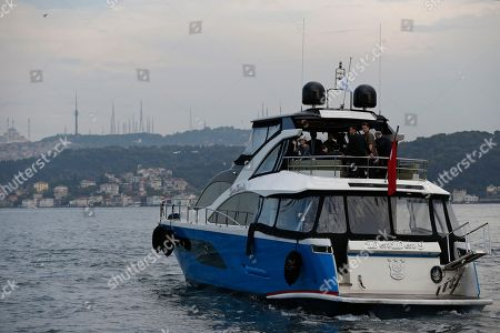 Stock Photo of Japan's Princess Akiko, waves as she embarks on a cruise in the Bosporus Strait, separating Europe and Asia, following a visit at the Besiktas Marine Museum in Istanbul
