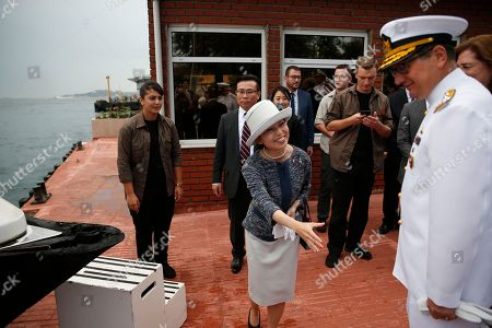 Japan's Princess Akiko shakes hands with Turkish naval officers before embarking on a mini-cruise in the Bosporus Strait, separating Europe and Asia, following a visit at the Besiktas Marine Museum in Istanbul