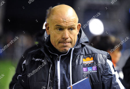 Richard Cockerill - Edinburgh head coach waits on the sideline to lambast referee Ian Davies at the end of the match for a poor performance after awarding a penalty count of 15-4 against Connacht.