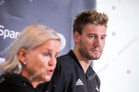 Rosenborg BK's Nicklas Bendtner (R) and CEO of Rosenborg BK, Tove Moe Dyrhaug, attend press conference in Trondheim, Norway, 11 September 2018. According to reports Bendtner was reported to the police by a Copenhagen taxi driver who claims the Danish striker was behind a violent attack on 09 September 2018.