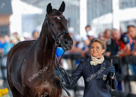 Dressage rider Dorothee Schneider and her horse Sammy Davis Jr of Germany participate in the dressage inspection during the FEI World Equestrian Games 2018 at the Tryon International Equestrian Center in Mill Spring, North Carolina, USA, 11 September 2018. The World Equestrian Games continue through 23 September 2018.
