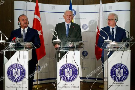 (L-R) Foreign Ministers of: Turkey Mevlut Cavusoglu, Romania Teodor Melescanu and Poland Jacek Czaputowicz attend a news conference during their meeting in Bucharest, Romania, 11 September 2018. The ministers meet for the fifth time in this trilateral format.
