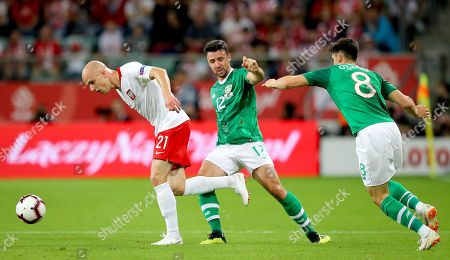 Poland vs Republic of Ireland. Ireland's Enda Stevens with Rafal Kurzawa of Poland